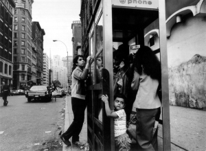Pic by Engel -1970's/80's NYC -family in phone booth